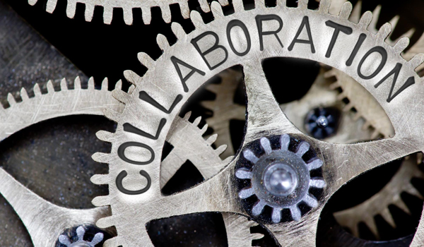 Spinning gears with the word collaboration on them