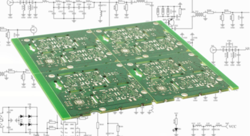 Picture of PCB on top of a schematic