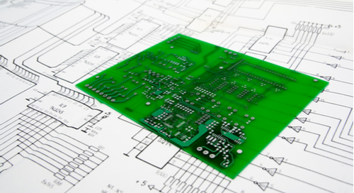 Green PCB on schematic background
