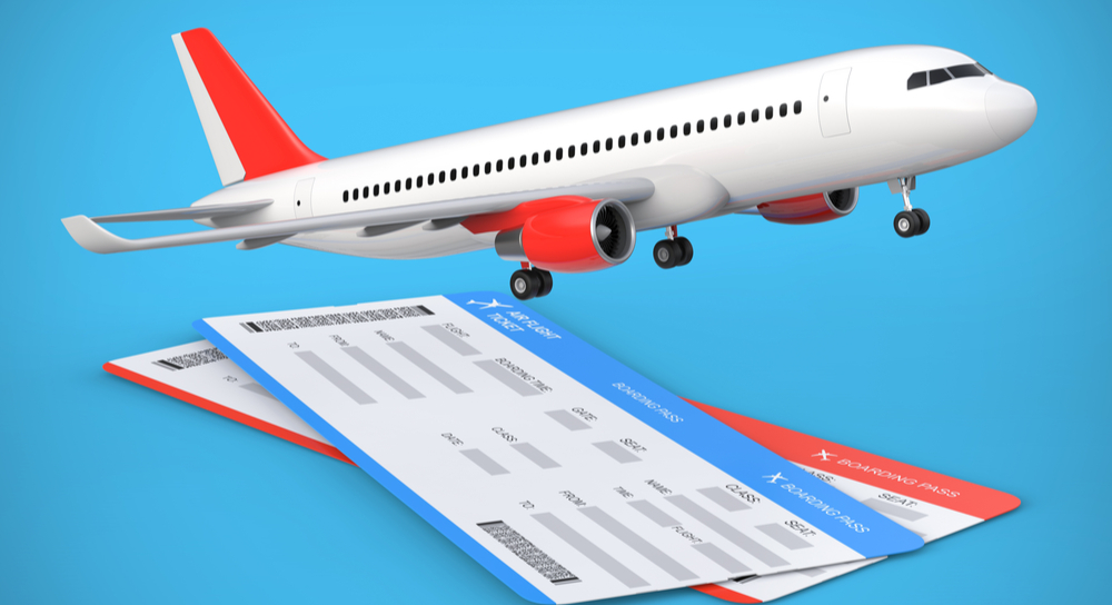 Picture of airliner and two travel tickets