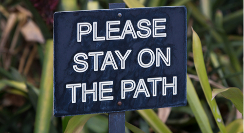 Sign advising you to stay on the path
