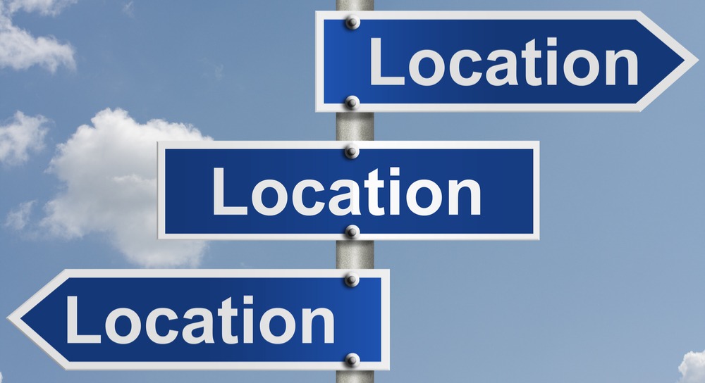 "Sign that says ""location"", ""location"", ""location"")"