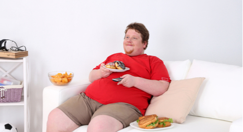 overweight man on couch