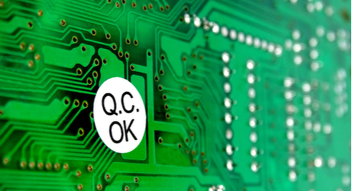 "PCB with a sticker saying ""Q.C. OK"""