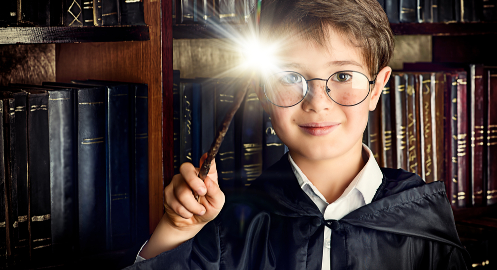 Boy with magic wand in