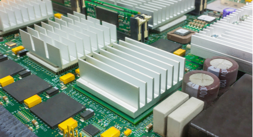 Board with large SMT heat sinks
