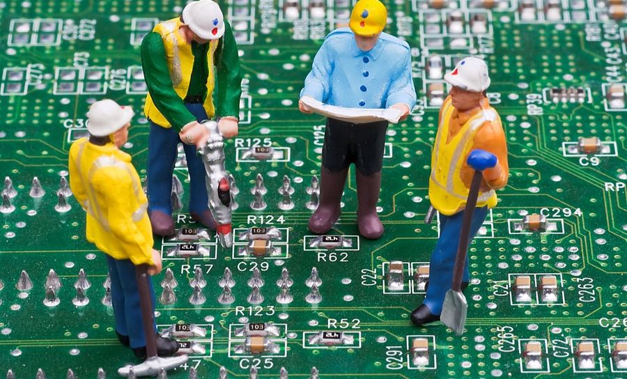 Engineers literally working on a PCB