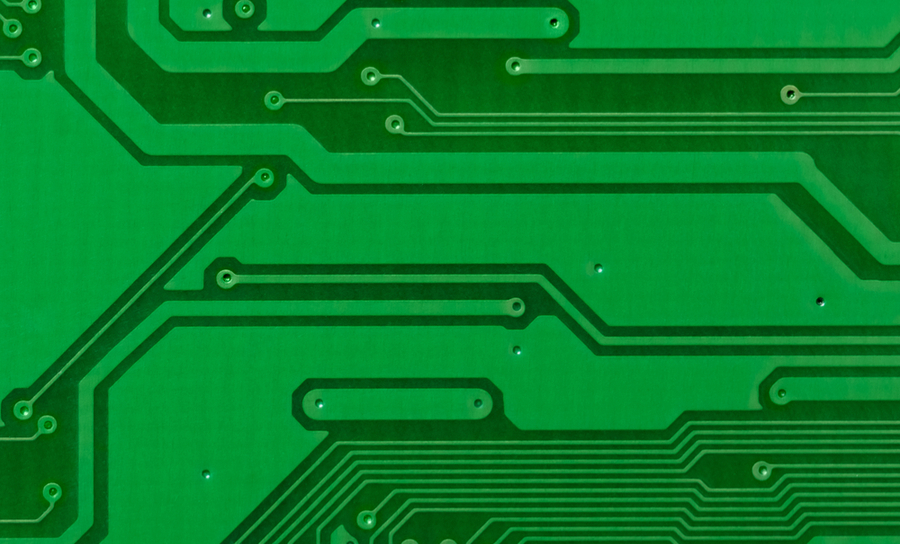 Traces and vias on a green PCB