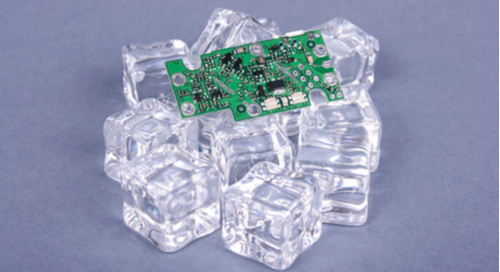 Green PCB on ice cubes