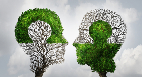 Two halves of trees in the shapes of heads looking at each other