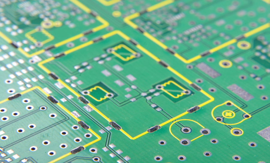 Vias on a green PCB with a silkscreen layer