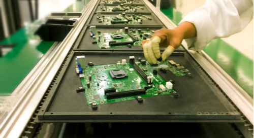 Researcher testing circuit boards
