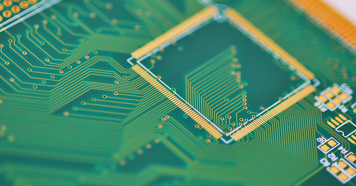 Complex trace routing and landing pads on a green PCB