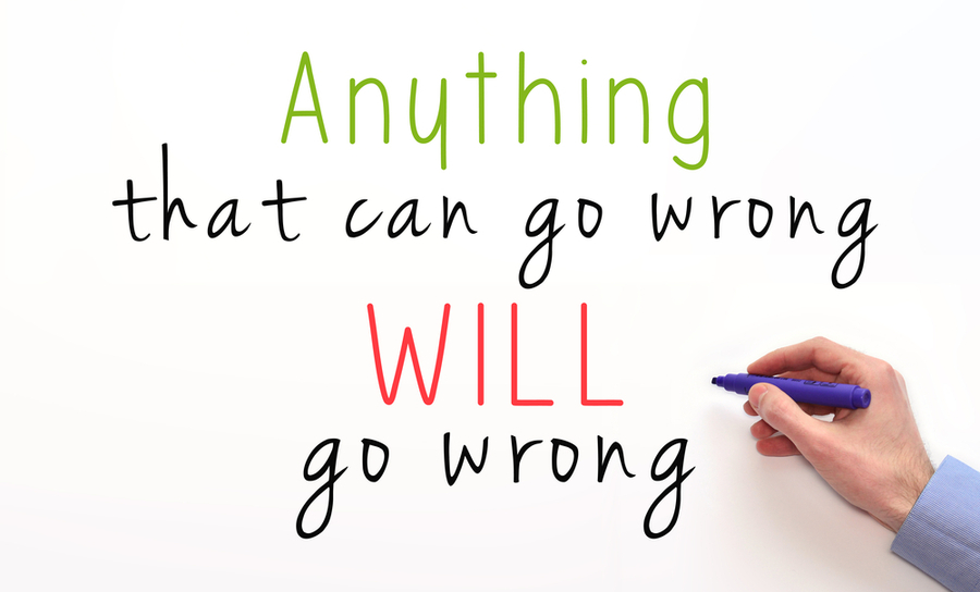 """Anything that can go wrong will go wrong"" written on a whiteboard"