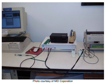 Impedance test equipment with a computer, multiple probes, and multiple devices at a PCB fabricator, photo courtesy of MEI Corporation.