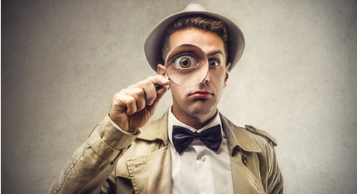 investigator-looking-magnifying-glass